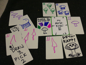 Mush-Ring!, a draw-and-play, take-that card game about growing a ring of mushrooms.